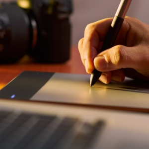 Artist Photographer Retouches Photo On Computer With Graphic Tablet