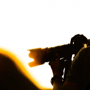 Photographers are shooting at sunset.